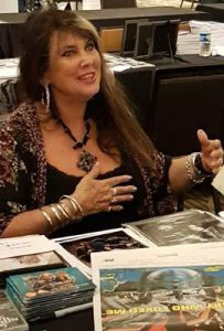 CAROLINE MUNRO Signs a SPY WHO LOVED ME Daybill Movie Poster image