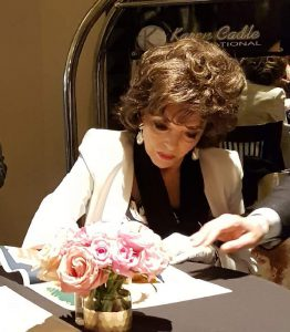 DAME JOAN COLLINS Signing an Australian Daybill Movie Poster image