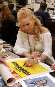 VERONICA CARLSON Signing a HORROR OF FRANKENSTEIN Daybill Movie Poster image